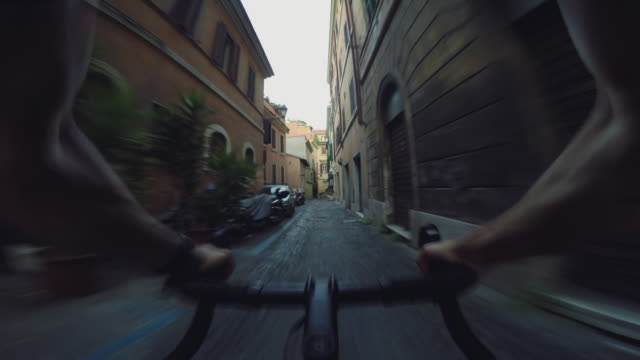 Commuter with racing bicycle in the center of Rome POV