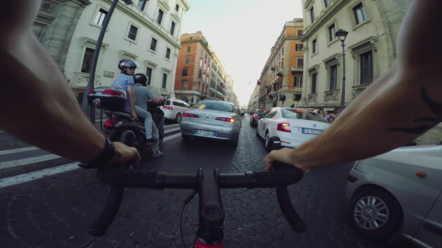 commuter with racing bicycle in the center of rome pov - instrument of time stock videos & royalty-free footage