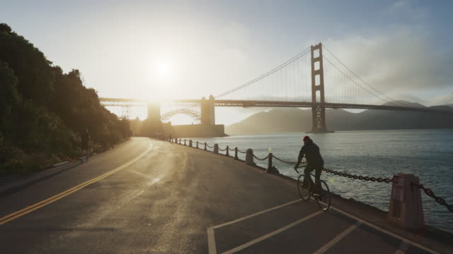 commuter with road racing bicycle and golden gate bridge - motorcycle biker stock videos & royalty-free footage
