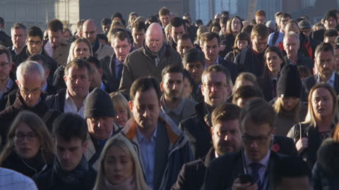 commuters 4k sidelight. - population explosion stock videos & royalty-free footage