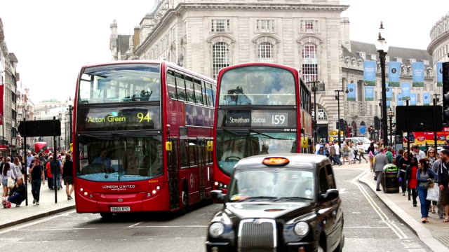commuters and busses at piccadilly circus - london - taxi stock videos & royalty-free footage