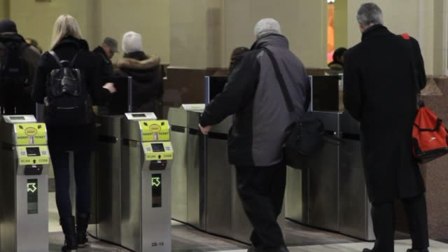 commuters and security at new jersey transit train station in secaucus new jersey on january 30 wide shot of a commuter going through the turnstile... - turnstile stock videos & royalty-free footage