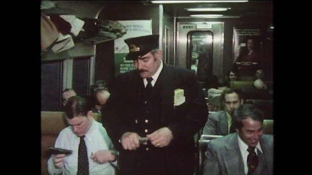 commuters and ticket inspector on busy nyc train; 1975 - newspaper stock videos & royalty-free footage