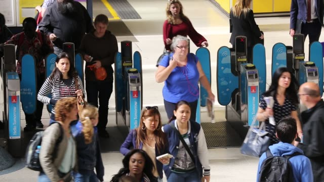 Commuters and tourists at Victoria Station in London, UK.