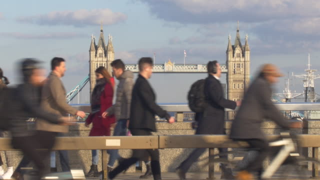 commuters and traffic crossing london bridge. - employment issues stock videos & royalty-free footage