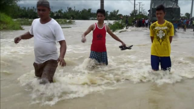 commuters are stranded by flooded roads in the northern philippines on saturday roads flooded as typhoon hits philippines on october 12 2013 in... - isola di luzon video stock e b–roll