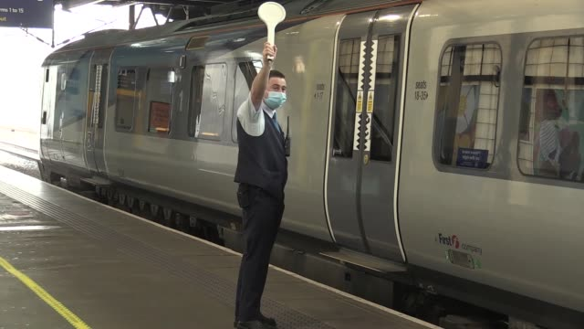 commuters arrive and depart at leeds railway station on the first day of mandatory wearing of face masks on public transport. - commuter stock videos & royalty-free footage