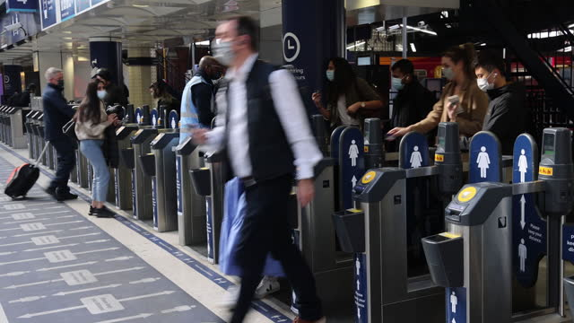 commuters arrive at london waterloo railway station in london, u.k., on thursday, may 27, 2021. more than half of workers in london's financial... - public transport stock videos & royalty-free footage