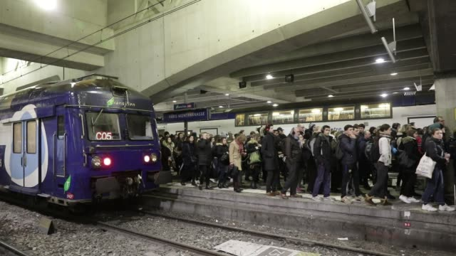 commuters arrive at montparnasse train station during strikes and interprofessional demonstrations against pension reform in paris on december 9 2019... - streik stock-videos und b-roll-filmmaterial