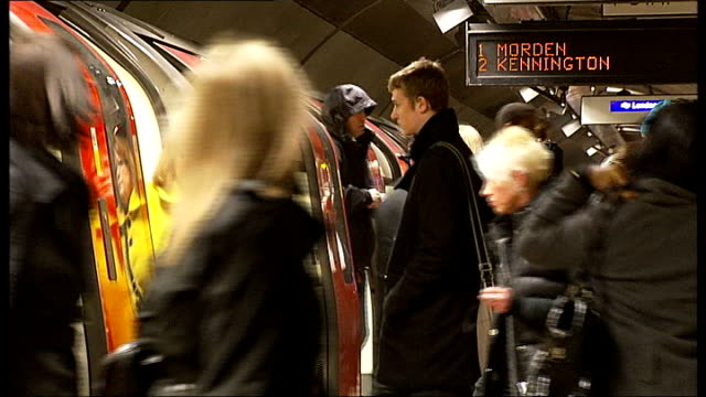 stockvideo's en b-roll-footage met commuters asked to avoid part of northern line during rush hour england london int passengers standing on platform next to tube train under 'morden'... - vermijden