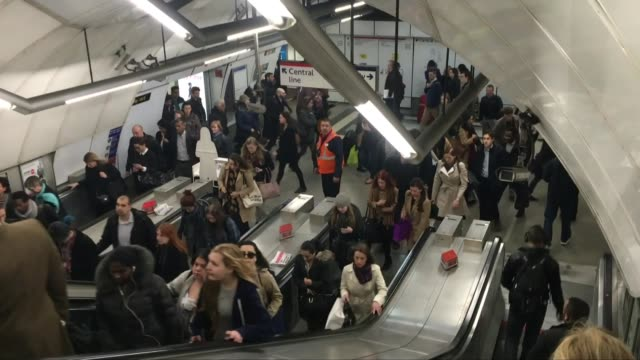 commuters asked to stand both sides of the escalators at tube station; england: london: int various shots people up tube escalators with some people... - hologram stock-videos und b-roll-filmmaterial