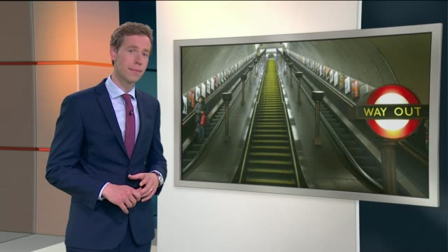 commuters asked to stand both sides of the escalators at tube station vox pops reporter to camera various shots people up london underground... - 懇願する点の映像素材/bロール