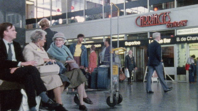 1978 montage commuters at a busy station sitting, waiting, and walking around / euston station, london, united kingdom - 1978 stock videos and b-roll footage
