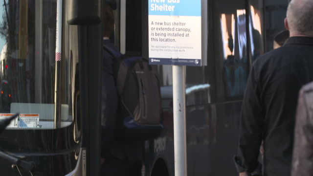 commuters boarding bus in city of auckland new zealand - pedestrian stock videos & royalty-free footage