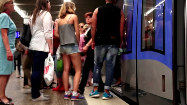 commuters boarding subway train time lapse - public transport stock videos & royalty-free footage