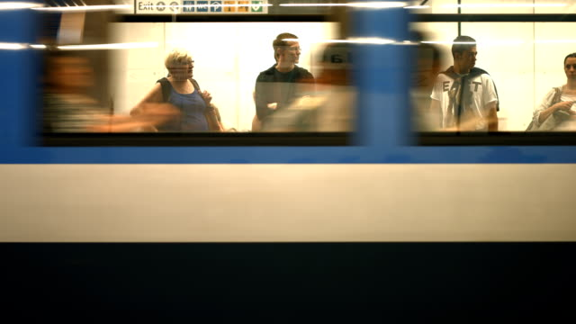 t/l commuters boarding subway train - munich stock videos & royalty-free footage