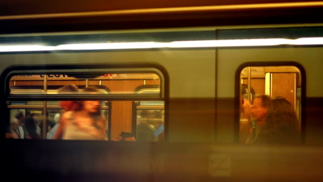 commuters boarding subway train - moving past stock videos & royalty-free footage