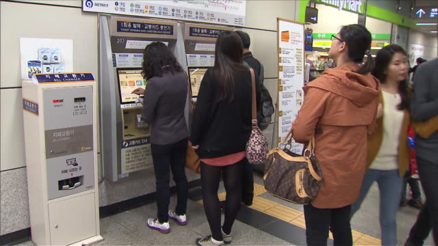 MS Commuters buying subway tickets from ticket machines  / Seoul, South Korea