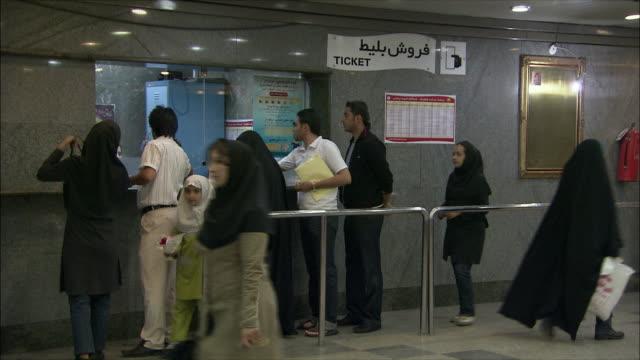ms commuters buying tickets in subway station, tehran, iran - fahrkartenschalter stock-videos und b-roll-filmmaterial
