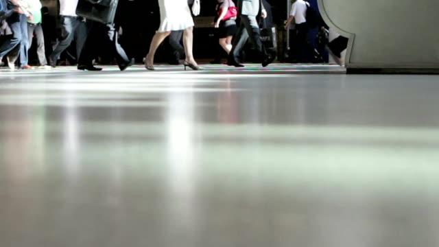 commuters close up feet & legs approaching escalator - human limb stock videos & royalty-free footage