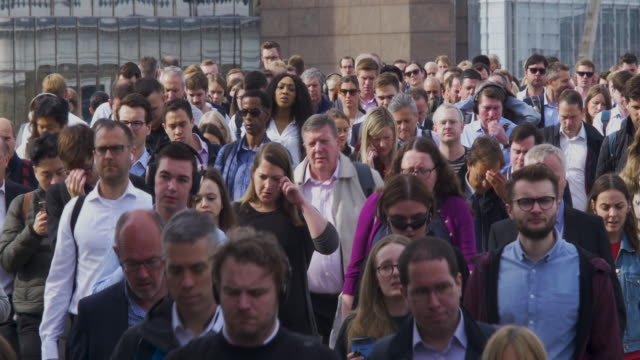 commuters crossing london bridge in the rush hour - population explosion stock videos & royalty-free footage