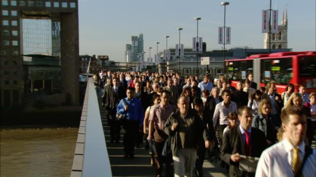 MS, commuters crossing London Bridge, London, England