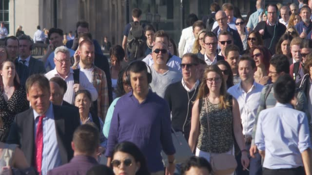 commuters crossing london bridge. - population explosion stock videos & royalty-free footage