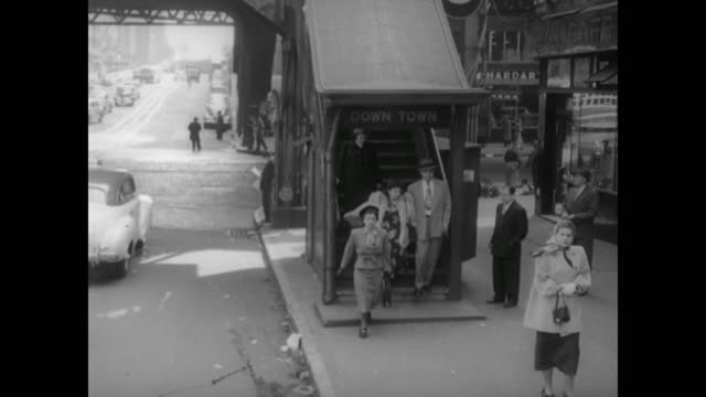 1948 nyc - commuters descend exit staircase at the 42nd street and 3rd avenue elevated subway station - 1948 stock-videos und b-roll-filmmaterial