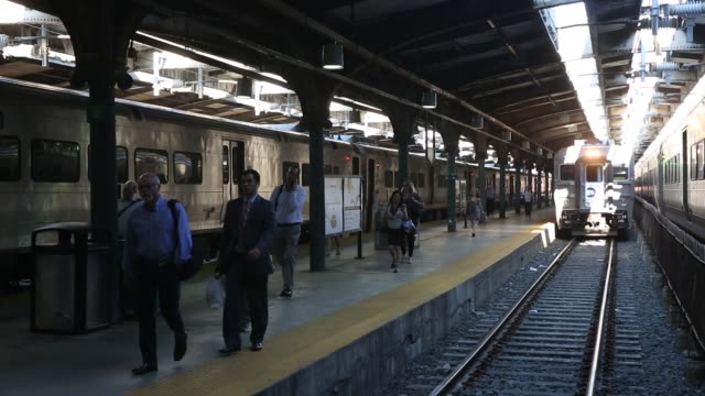 commuters disembark from new jersey transit trains to take ferries or path trains during a morning commute to penn station on the first day of... - monday morning stock videos & royalty-free footage