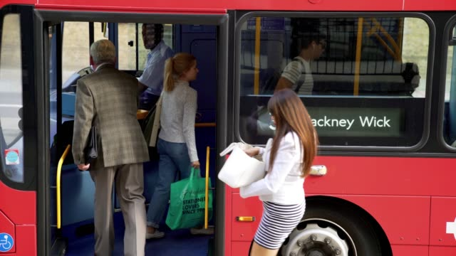 commuters entering double-decker bus in london - bus driver stock videos & royalty-free footage
