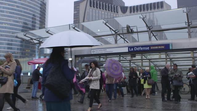 """vidéos et rushes de commuters exit esplanade de la defense metro station paris - """"bbc news"""""""