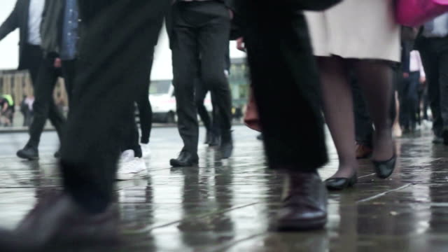 commuters going to work in the rain    com - classified ad stock videos & royalty-free footage