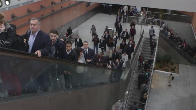 """vidéos et rushes de commuters going up escalators at la defense metro station in paris - """"bbc news"""""""