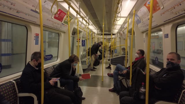 commuters in face masks in a subway train amid coronavirus pandemic in london, uk, on monday, october 12, 2020. - underground train stock videos & royalty-free footage