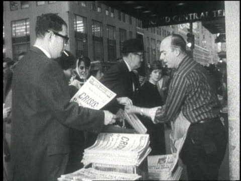 commuters in grand central station buy newspapers to read about the cuban missile crisis. - 1962 stock videos & royalty-free footage