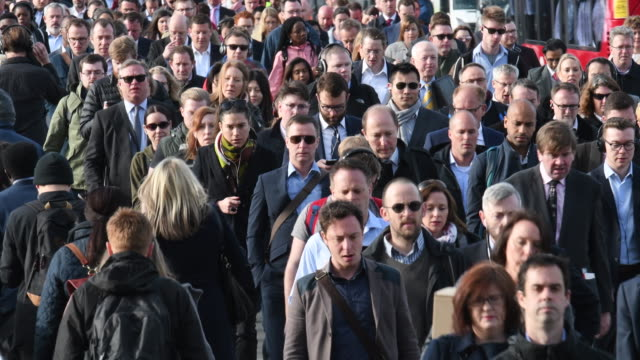commuters in london rush hour walking to work - front view stock videos & royalty-free footage