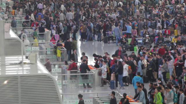 commuters in modern train station - crowded airport stock videos & royalty-free footage