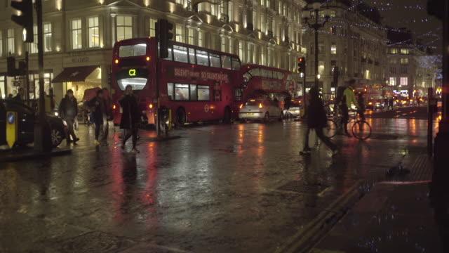 commuters in regentstreet london walking in the rain - umbrella stock videos and b-roll footage