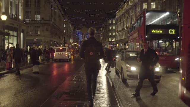 commuters in regentstreet london walking in the rain - west end london stock videos and b-roll footage