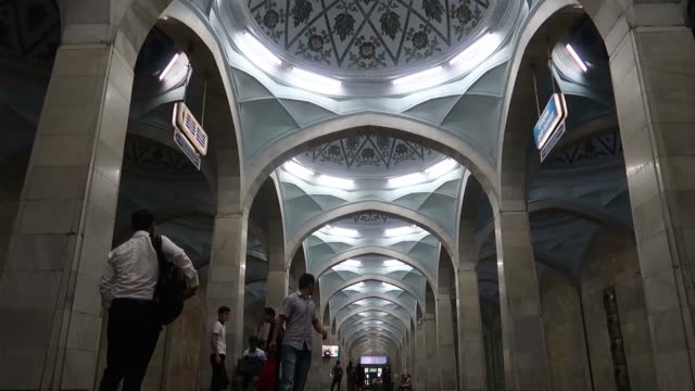 commuters in the alisher navoi station at the tashkent underground metro in uzbekistan. the tashkent metro built in the former ussr is one of only... - eddie gerald stock videos & royalty-free footage
