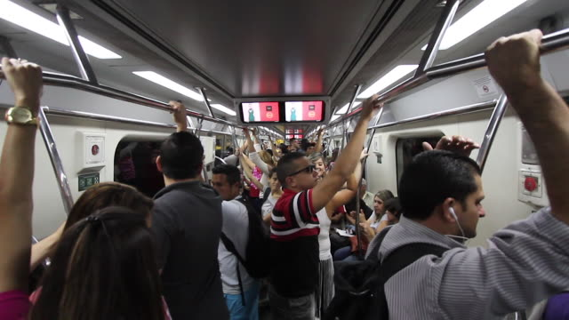 Commuters in the crowded subway NO