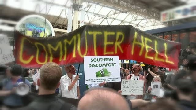commuters injured by falling ceiling panel on southern rail train; t11071602 / tx england: london: victoria station: int general view southern rail... - newspaper strike stock videos & royalty-free footage
