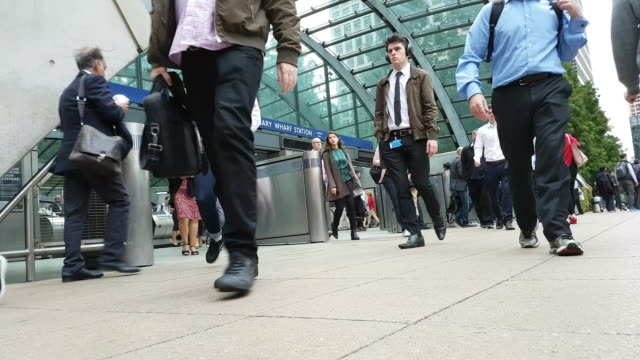 commuters leaving london canary wharf tube station - finance and economy stock videos & royalty-free footage