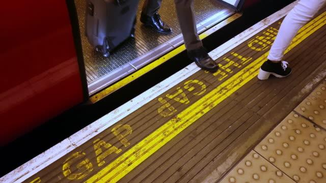 commuters leaving london underground train - underground station platform stock videos & royalty-free footage
