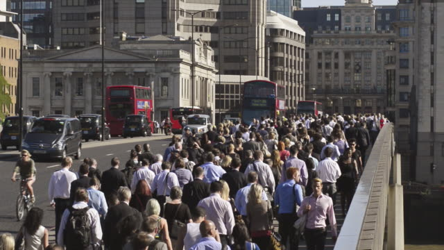 commuters make their way across london bridge - london bridge england stock videos & royalty-free footage