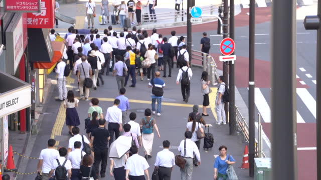 commuters make their way through the shinjuku area of tokyo japan on thursday august 8 2019 - railway station stock videos & royalty-free footage
