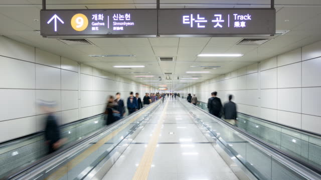 Commuters on an escalator in Seoul's Subway System, Seoul, South Korea, Asia
