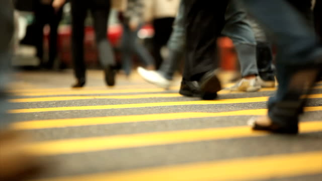 commuters on crosswalk - low angle view stock videos & royalty-free footage