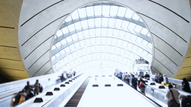 commuters on escalator at subway station canary wharf, docklands london - canary wharf stock videos & royalty-free footage