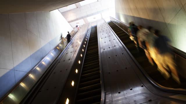 ws la t/l commuters on escalator at subway - escalator stock videos & royalty-free footage